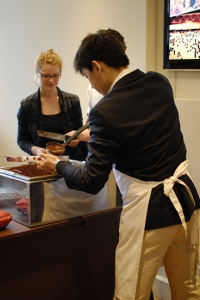 Dancer Sam Pu makes chocolate at La Maison de Chocolat (TK).