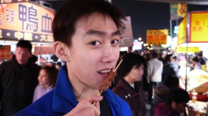 You can tell from Principal Dancer Rocky Liao's face how much he's enjoying this lamb kebab.
