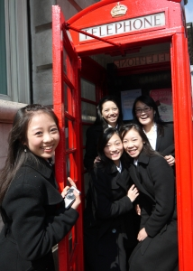 "Our dancers enjoyed a ""touristy"" moment jumping into this phone booth. (Annie Li)"