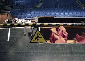Don't fall into the orchestra pit—your hat might come off.