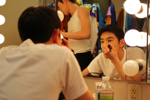 Dancer Peter Huang preparing for a show, 2011. (Sebastien Chun)