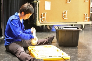 Dancer Henry Huang preparing backstage, 2011. (Sebastien Chun)