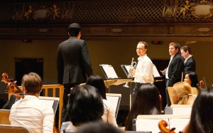 Conductor Yohei Sato and trumpet players (from left) Alexander Wilson, Eric Robins, and Kaspar Martig rehearse Leroy Anderson's 'Bugler's Holiday.'