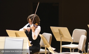 Concertmaster Astrid Martig prepares for the performance at Boston Symphony Hall Oct. 4.