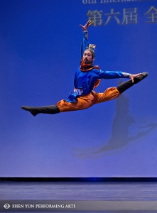 "Shen Yun Principal Dancer Peter Huang, gold winner of the male adult division, performs ""Drinking Alone by the Moonlight"" at the International Classical Chinese Dance Competition."