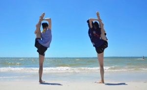 Stretching on the beach - Lily Wang and Vicki Cao practicing a classical Chinese dance technique called chao tian deng - 朝天凳. (photo by Seron Guang Ling Chau)