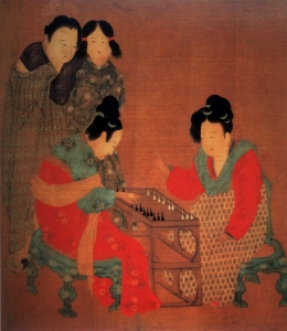 Tang Dynasty painting: Two ladies play a game while their attendants watch on. The colorful silks and elaborate hairstyles of the seated women are an indicator of their higher rank. In comparison, the handmaidens in the background wear simple robes and hair in practical styles.