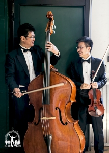 Bassist Wei Liu and violinst James Hwang have a chat before warming up.