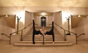Cheney Wu, left, and Principal Dancer Claudia Yang enjoy the War Memorial Opera House's symmetry.