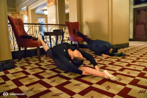Dancers Angelina Liu (left) and Chelsea Cai make stretching look like they are sleeping. Literally. (photo by Annie Li)