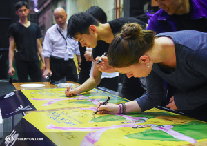 Before leaving Melbourne, performers signed two posters as souvenirs.  (photo by dancer Ben Chen)