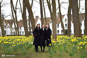 Dancers Yi-Qian Shi, Chunqiao Cai, and Connie Kuang enjoy the fresh field of flowers in the old town of Bruges. (photo by dancer Diana Teng)