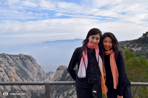 Principal dancers Miranda Zhou-Galati and Daoyong Zheng pose in front of the breathtaking view @ 975 meters.  (photo by Diana Teng)