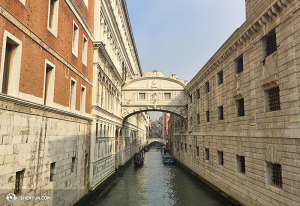 The famous Bridge of Sighs. It is so named due to its sad history: prisoners would be sentenced at the Doge's Palace, left, and were sent to their doom to the executioners, on the right. The one-way trip would be made across this bridge, hence the name. (photo by projectionist Annie Li)