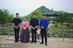 "Dancers (from left) Patrick Trang, Jason Pan, and Joe Huang with a woman dressed in traditional Korean garb at the Hyangwonjeong Pavilion, meaning ""The Pavilion of Far-Reaching Fragrance."" (photo by dancer Jun Liang)"