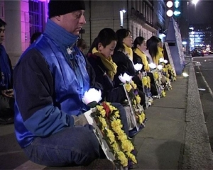 Another silent vigil in remembrance of thousands of Falun Gong practitioners who had been tortured to death in custody in China. Ben Chen is 12 here. (photo courtesy of Minghui.org)