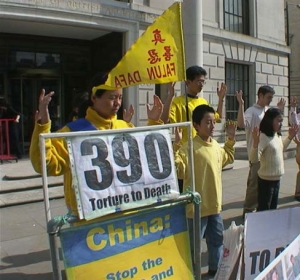 10-year-old Ben Chen stands next to his mother and other Falun Gong practitioners as they perform meditation exercises in front of the embassy. (photo courtesy of Minghui.org)