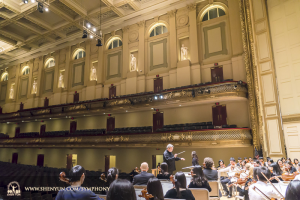 After New York, the orchestra traveled to Boston. Here, conductor Milen Nachev leads a rehearsal on stage at Boston Symphony Hall.