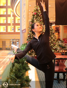 Shen Yun Touring Company Principal Dancer Xindi Cai warms up in a Christmas-adorned lobby of the Aronoff Center for the Arts in Cincinnati, Ohio. (Photo by dancer Helen Li)