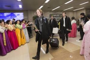 Shen Yun sound engineer Jacob Wallenberg (left) followed by trombone player Alistair Crawford and bassist Juraj Kukan upon arrival in South Korea.