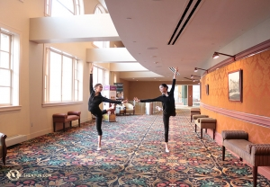 Dancers Cherie Zhou (left) and Diana Teng warm up before a performance at The Hippodrome Theatre in Baltimore. (Photo by dancer Helen Li)