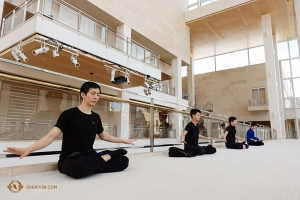 After a training session, dancers like Steve Feng (left) balance intense action with moments of inner peace, practicing Falun Dafa meditation accompanied by soft music. (Photo by Jeff Chuang)