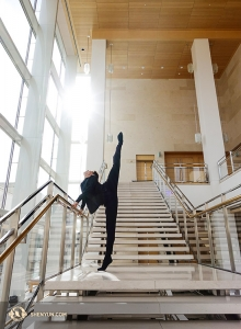Principal Dancer Rubi Zhang, who has been wowing audience members with his jump splits, warms up in Madison. (Photo by Jeff Chuang)