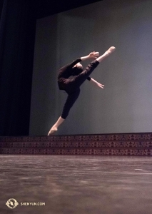 Dancer Michelle Wu warms up at Teatro degli Arcimboldi in Milan. What you can't tell from the photo is how slanted the stage is, sloping down toward the audience. In Europe, downstage is often literally down. (Photo by dancer Stephanie Guo)