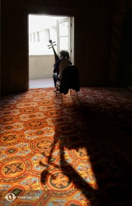 "Inside the cool lobby of the Phoenix Orpheum Theatre, Liang Yu practices her pipa, or four-stringed Chinese ""lute."" (Photo by projectionist Annie Li)"