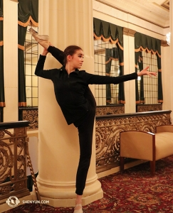 "Not to be outdone by Elsie Shi, dancer Yuqin Xin performs a ban pangtui, or side-leg stretch. To fluidly and ""effortlessly"