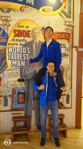 "It takes one and a half men, as demonstrated by dancers Kelvin Diao (top) and Tony Xue (bottom), to match heights with the world's tallest man who stood 8'11"" (2.72 meters). His shoes are on display at the Pike Place Market. (Photo by Daren Chou)"