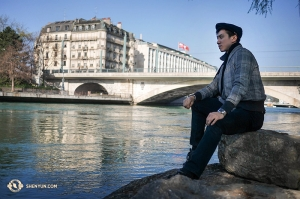 Principal Dancer Rocky Liao looks over the Geneva Rhone River. (Photo by Songtao Feng)