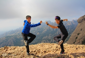 Even the day after two performances in Barcelona, many in the group hiked all the way up. At the top, dancers Jeff Chuang (left) and Rui Suzuki still had energy to monkey around. (Photo by Songtao Feng)