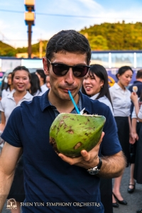 Taiwan is a tropical island, so sipping fresh coconut from a straw is a must. Assistant concertmaster Arsen Ketikyan at a seaside rest stop.