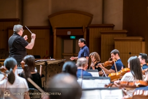 Tenor Tian Ge and the symphony test out acoustics at Hsinchu Performing Arts Center.