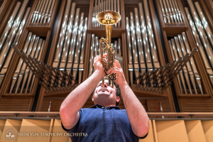 Principal trumpet Eric Robins feeling the power of the brass.