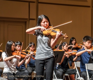 Soloist Fiona Zheng playing with passion.