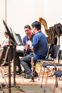 Clarinetists Kiril Penchev and Yuen-Suo Yang work on their synergy.
