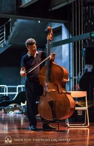 Bassist Wei Liu prepares for rehearsal.