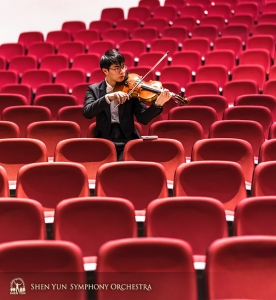 Violist Tongsheng Ye warms up in the sea of audience seats.