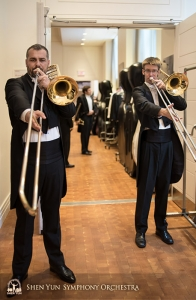 Behind the stage at Carnegie, principal trombonist Alexander Moraru (L) and trombonist Alistair Crawford warm up together with long tones.
