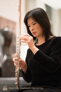 Principal flutist Chia-Jung Lee prepares her flute for the concert.