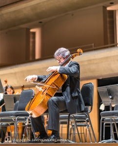 Cellist Alexander Dardykin grabs a precious opportunity to practice on stage.