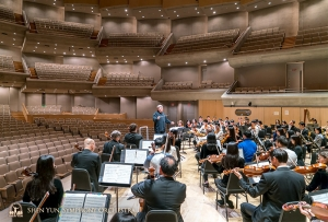 Conductor Milen Nachev leads rehearsal at Roy Thomson Hall.