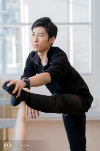 Jay Huang stretches in one of the rehearsal rooms at the theatre.