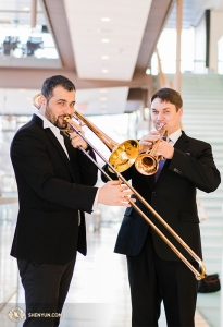 Trombonist Alexandru Moraru and trumpeter Vladimir Zemtsov use the open space in the lobby to practice.