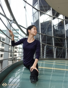 Linjie Huang uses the railing to steady her splits at the Sydney Lyric Theatre. The International Company was in town for seven performances from February 7–11. (Photo by projectionist Annie Li)