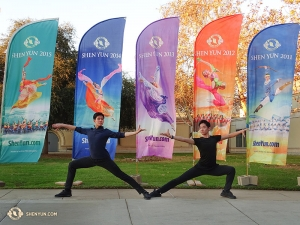 Dancers Danny Li and Henry Hong (right) pose in front of five colorful Shen Yun banners in Escondido. Currently, this company is in London for 14 sold-out shows! (Photo by dancer Tony Zhao)