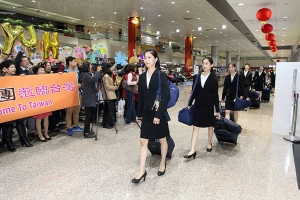 Principal Dancer Elsie Shi followed by other dancers arrive with their luggage in Taiwan.