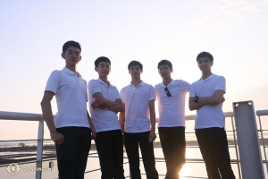 Taking a break between shows, dancers Victor Li, Ben Huang, David Xiao, Scott Xu, and Allen Liu (L-R) pose in front of the salt fields in Tainan, Taiwan. (Photo by dancer Nick Zhao)
